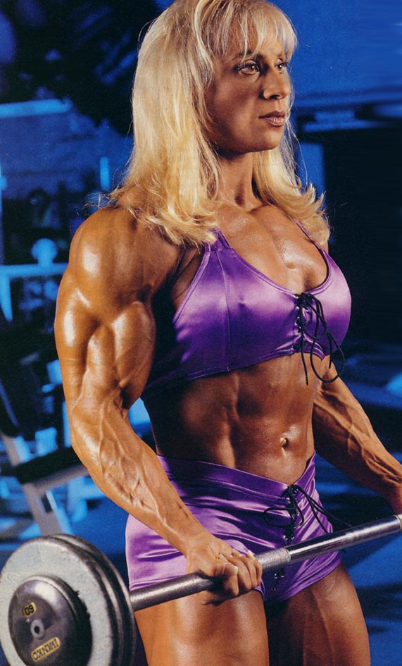The peerless Kim Chizevsky could care less if you think muscles aren't sexy on a woman. You go girl! Keep pumping those biceps!
