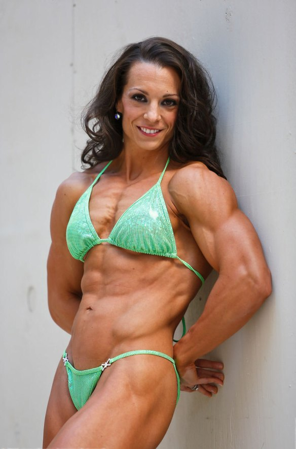 Toni West is so strong, muscular, beautiful and feminine. A perfect combination.