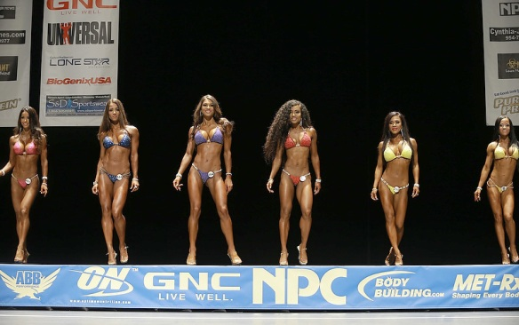More gorgeous female muscle ladies strutting their stuff on stage.
