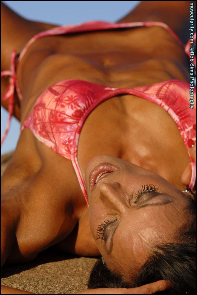 Deidre Pagnanelli lying down in a bikini.