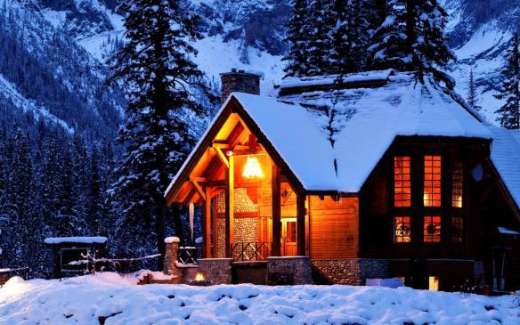 A picturesque log cabin in winter.