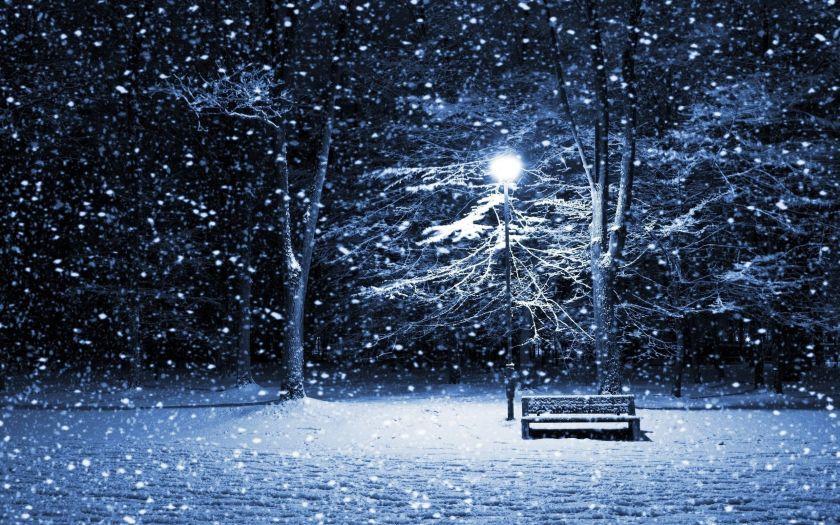 Beautiful wallpaper image of snowfall at night.