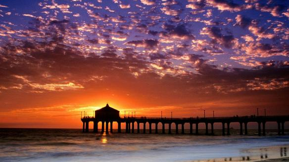 A romantic beach at sunset.