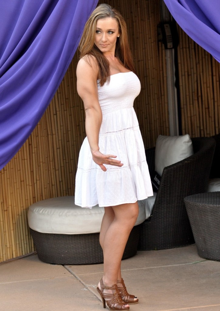 Erica Cordie showing off her triceps while wearing a gorgeous white dress.