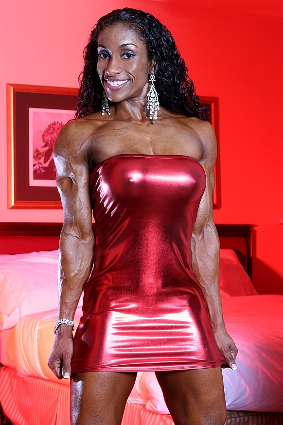 Love the tight red dress Glenese Markes is wearing.