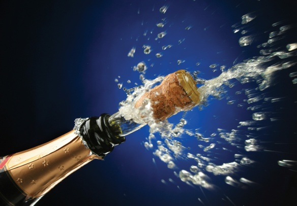 A bottle of champagne being uncorked.