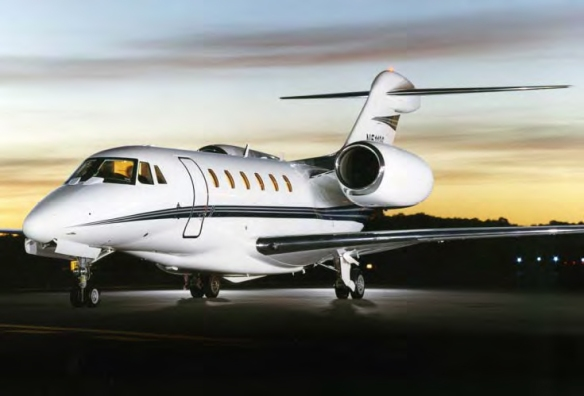 A private white jet preparing for takeoff.