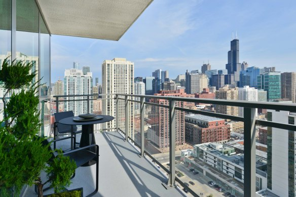 A simple outdoor balcony overlooking a major metropolitan city (in this case, Chicago).