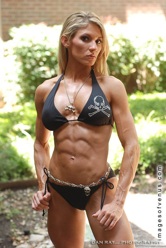 Abby Marie showing off her impressive set of abdominal muscles.