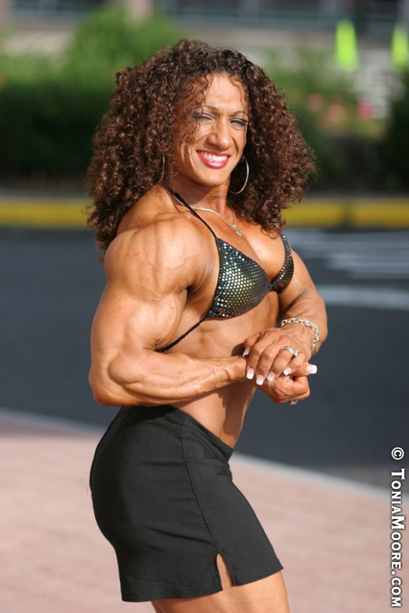 I demand to touch the arms of Tonia Moore. May I?