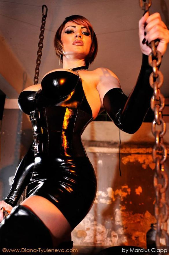 Diana Tyuleneva wearing a hot BDSM outfit.